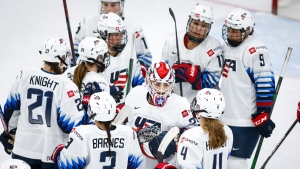 Knight sets record as USA routs Japan to advance