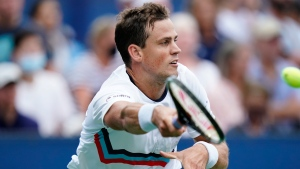 Pospisil rallies from two sets down to beat Fognini at US Open