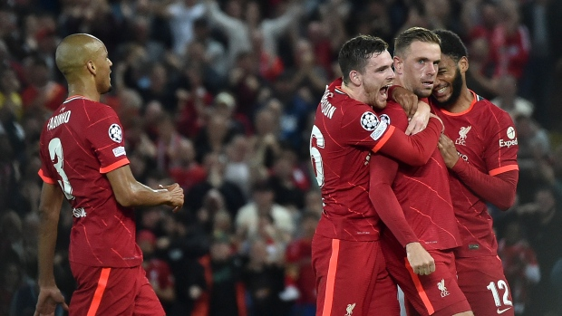 Henderson clinches win for Liverpool over AC Milan in CL