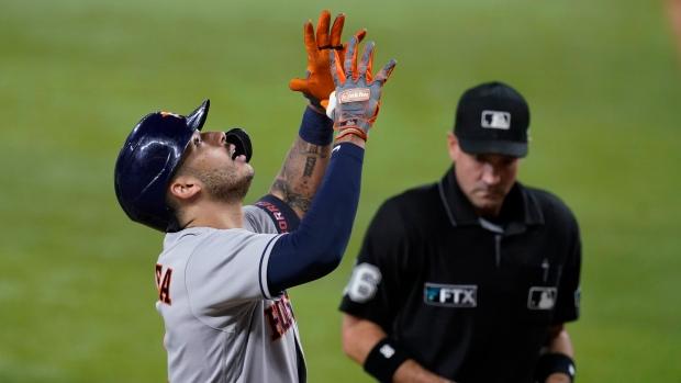 Correa HR triggers seven-run 4th, Astros roll past Rangers
