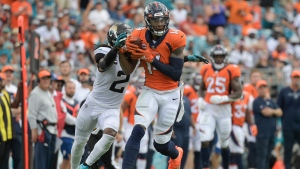 Sutton's career day helps Broncos beat woeful Jaguars