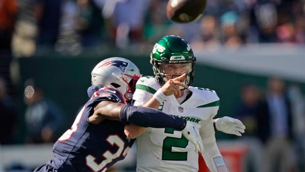 Jones, Patriots breeze past Jets as Wilson throws four interceptions