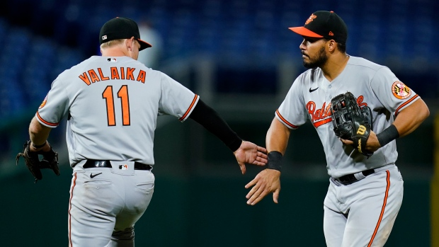Phillies' NL East-chase hindered in loss to 100-loss O's