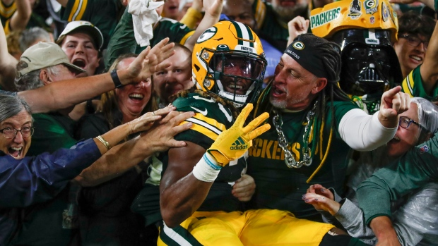 Jones scores four TDs as Packers bounce back to beat Lions