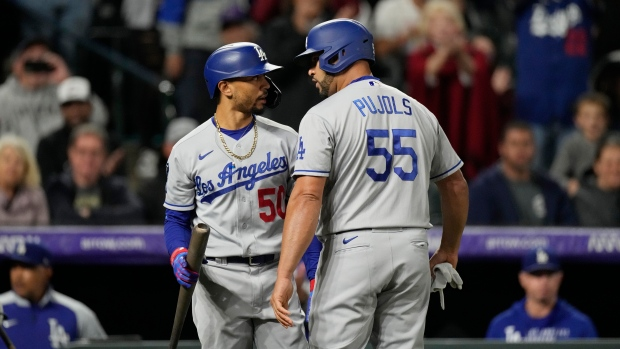 Pujols delivers single in 10th, Dodgers beat Rockies