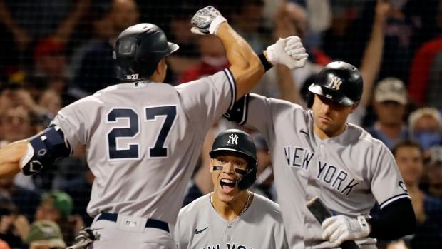 Yankees sweep, beat Red Sox to take AL wild-card lead