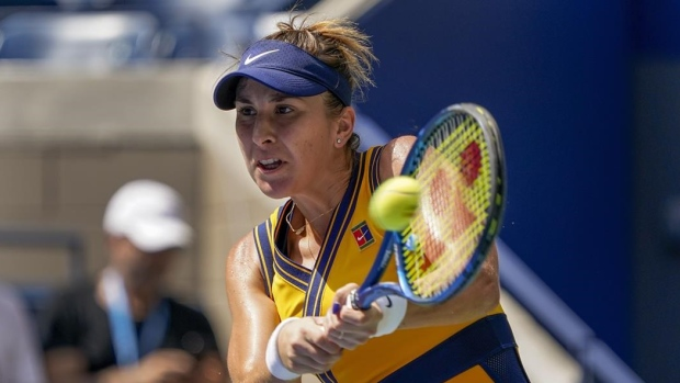 Olympic champ Bencic comes back to advance in Chicago