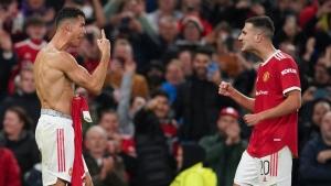 Record-breaker Ronaldo scores late winner for United in Champions League