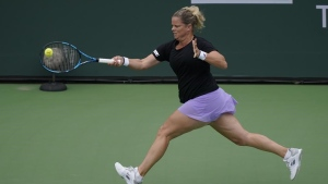 Clijsters loses in three sets in first round at Indian Wells