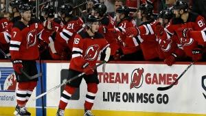 Hughes scores two, lifts Devils past Blackhawks in OT