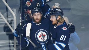 Connor scores twice, powers undermanned Jets to win over Ducks
