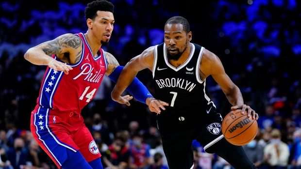 Durant's triple-double rallies Nets past 76ers