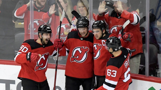 Zacha scores in OT to lift Devils past Sabres