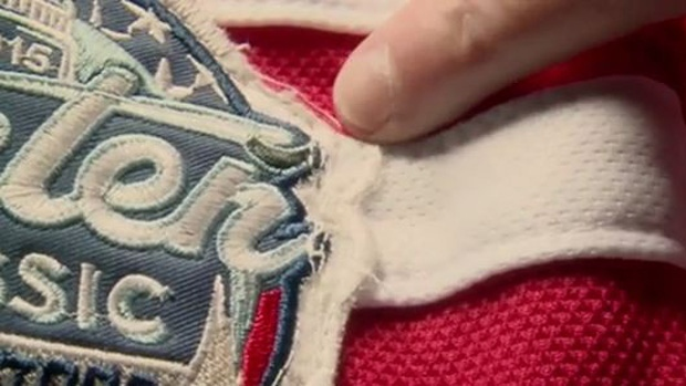 hot sale online 91482 e82c3 Faking It: The real cost of fanwear - TSN.ca