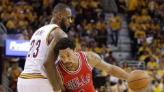 Derrick Rose drives on LeBron James