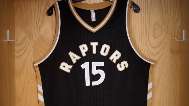 Black and gold raptors jacket