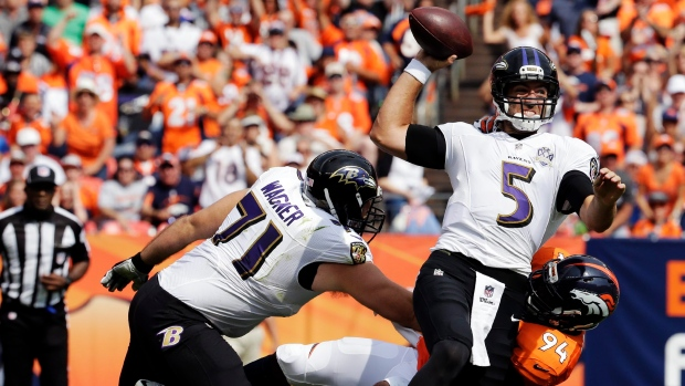 Flacco sacked by Ware