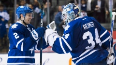 Matt Hunwick and James Reimer