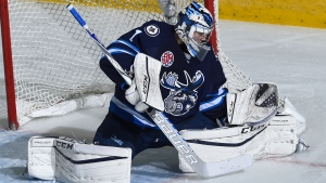 Comrie makes 32 saves, Moose down Heat