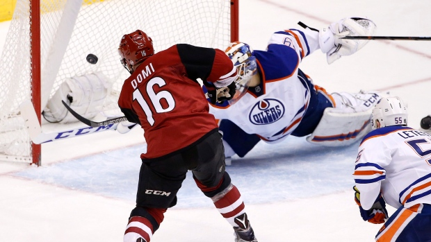 Coyotes-max-domi-16-scores-a-goal-on-edmonton-oilers-anders-nilsson