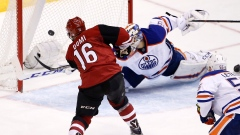 Coyotes' Max Domi (16) scores a goal on Edmonton Oilers' Anders Nilsson
