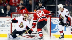 Devils center Joseph Blandisi (64) scores his first career goal against Ottawa Senators goalie Craig