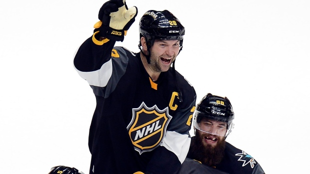 Teammates lift John Scott