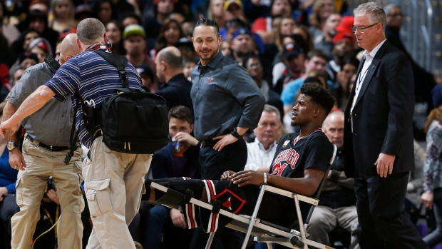 Jimmy Butler carted off