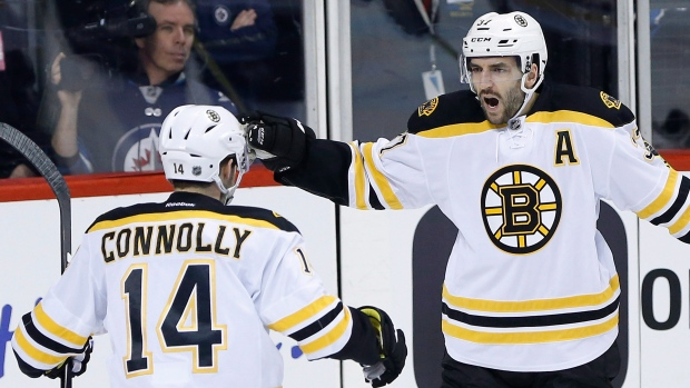 Connolly, Bergeron celebrate