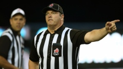 CFL referee indicates a penalty