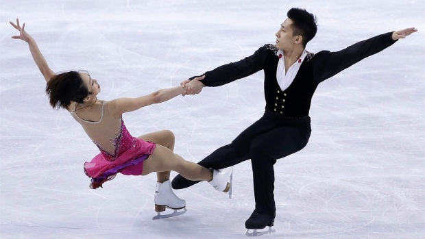 China claims gold in pairs at figure skating worlds