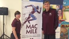 Glen Grunwald poses with a student at launch of Mac Mile