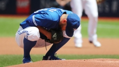 Marco Estrada stretches his back