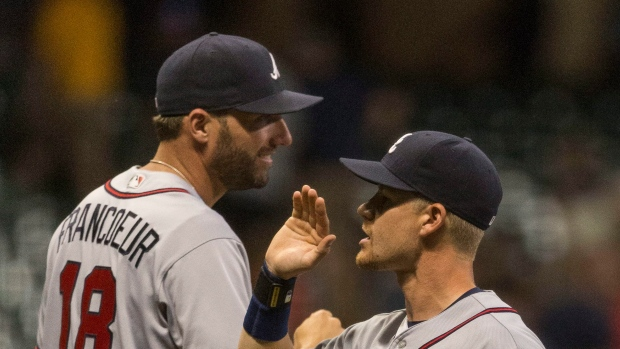Jenkins throws 6 strong innings, Braves beat Brewers 2-1