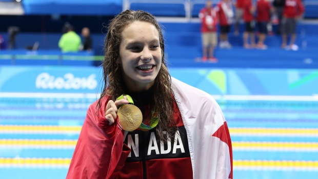 Manuel hopes her gold can inspire African-American swimmers