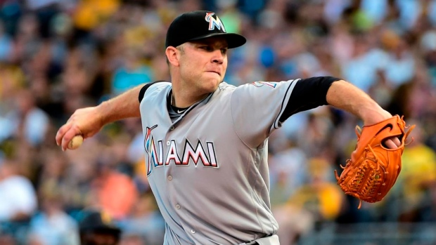 Marlins trade David Phelps to Mariners for four prospects