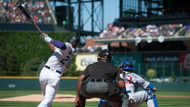 Arenado's 2 home runs, 6 RBIs power Rockies past Cubs