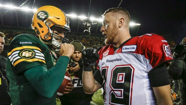Mike-reilly-bo-levi-mitchell-shake-hands