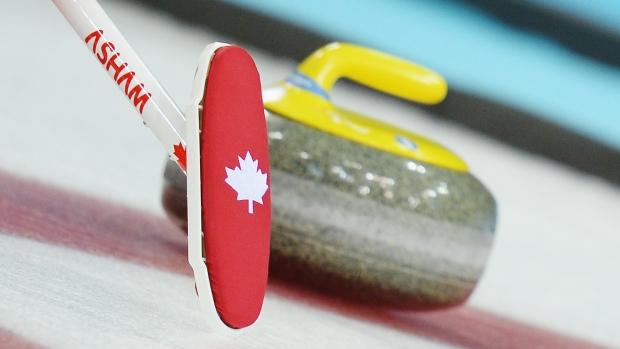 Curling-broom-and-rock