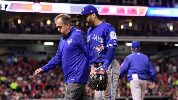 Jays' Devon Travis leaves for MRI; team adds Smoak to roster