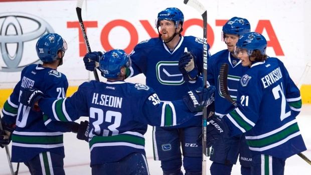Canucks players celebrate