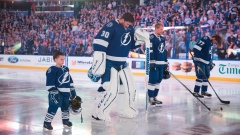 Lightning players and 'Lightning Kid' stand for national anthems