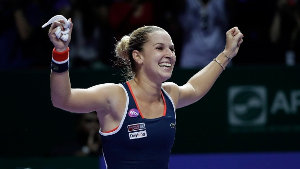 Kerber helps Cibulkova advance in Singapore