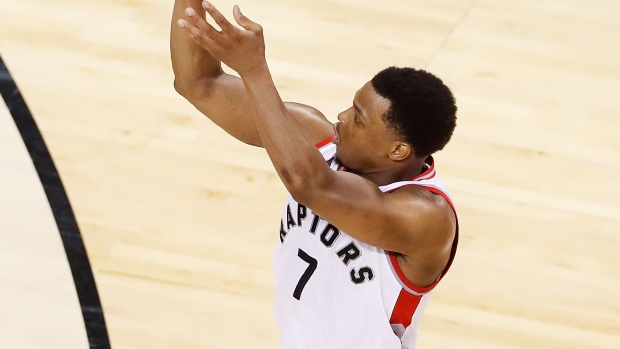Kyle-lowry-shoots-over-j-r-smith