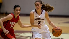 McMaster's Danielle Boiago drives past a Brock University defender