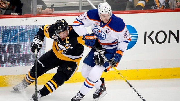 Sidney-crosby-and-connor-mcdavid-battle-for-the-puck