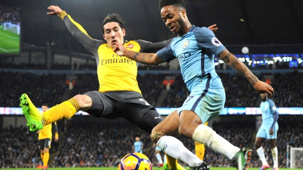 Arsenal's Hector Bellerin and Manchester City's Raheem Sterling