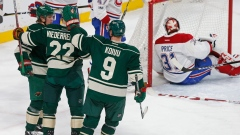 Minnesota Wild celebrate beside Carey Price