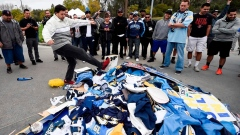 San diego Chargers fans pile jerseys for burning