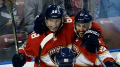 Jaromir Jagr celebrates his goal with Panthers teammates